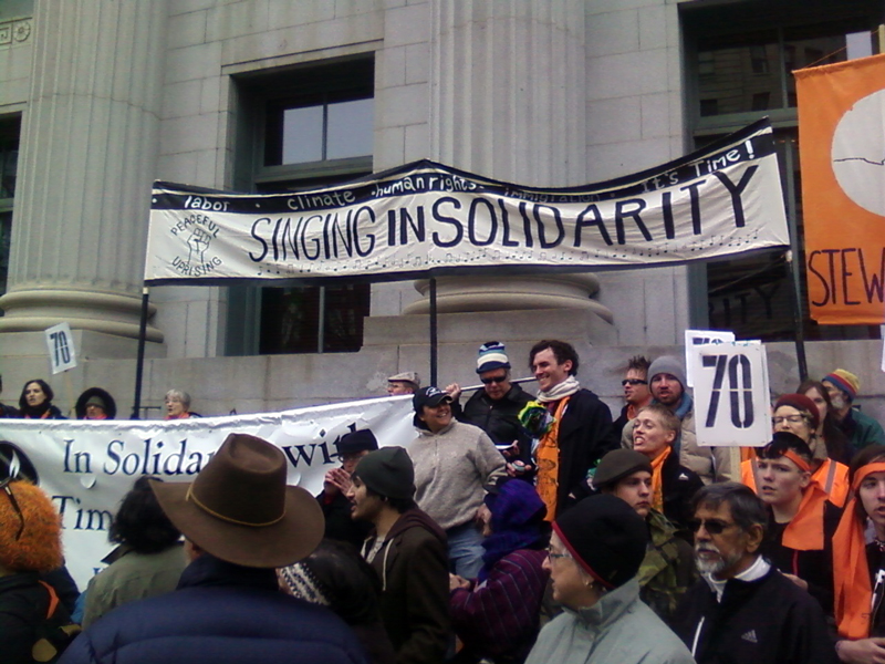 "peaceful uprising: i helped paint the banner ""singing in solidarity"""